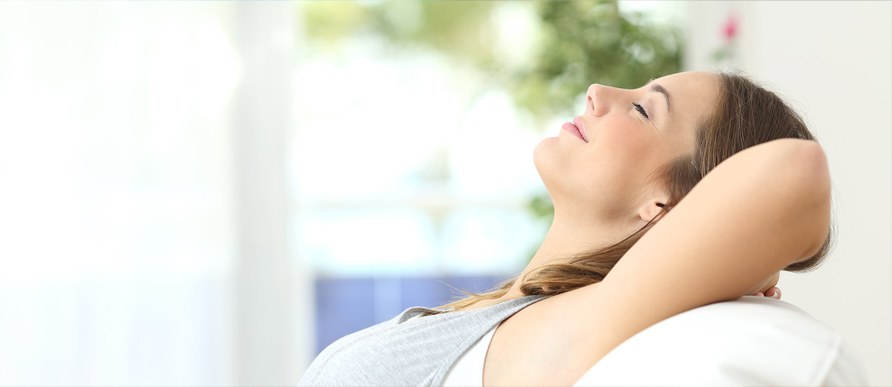 Woman lying back comfortably, Rest with eyes closed